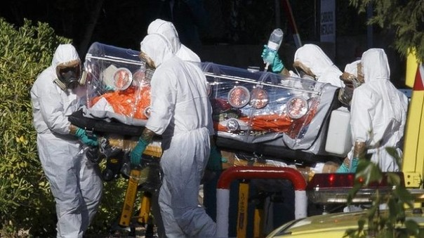 Spanish nurse being transported to hospital in Spain.